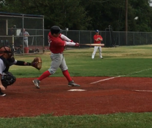 Eli B playing baseball