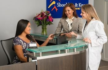 staff in the lobby at Shoulders & Knees Steven Struhl MD office